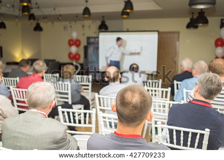 people in a conference room listening a business presentation.  - stock photo