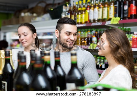 People in a liquor store are buying wine at a discount - stock photo