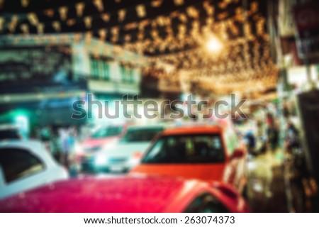 people in bokeh, street of night Bangkok, taxi and tuk-tuk - stock photo