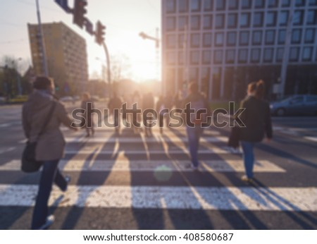 People in  bokeh, street of Wroclaw, Poland. Photo with light toning. - stock photo