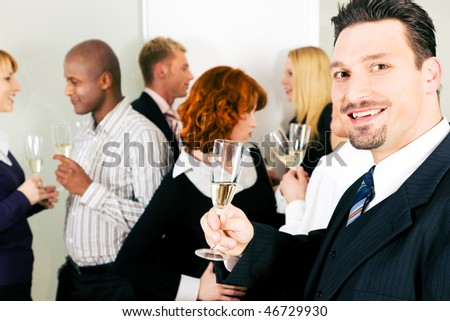 People in business outfit celebrating something in the office or at a gathering, maybe they toast on a successful deal or something the like - stock photo