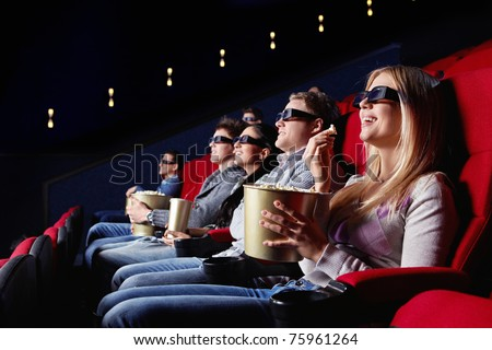 People in 3D glasses in cinema - stock photo