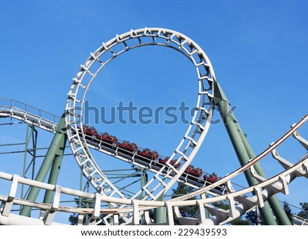 people in roller coaster on amusement park in holland - stock photo