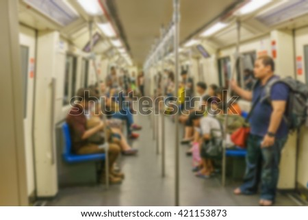 people in subway train blur focus for background shot - stock photo