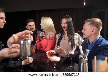People in the bar. night club - stock photo