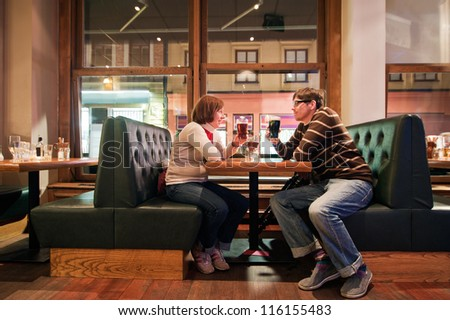 People is drinking beer in pub - stock photo
