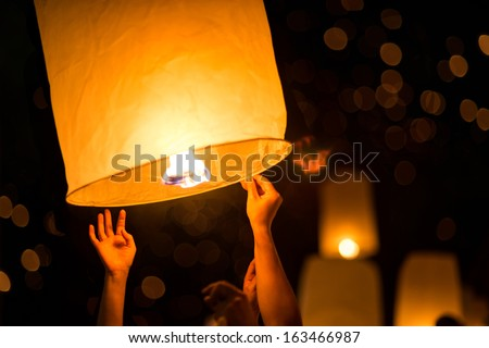 People is launching sky lantern to the sky - stock photo