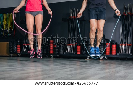 People legs doing exercises with jumping ropes - stock photo