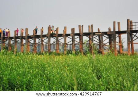 People Life on U Bein Bridge in Myanmar - stock photo