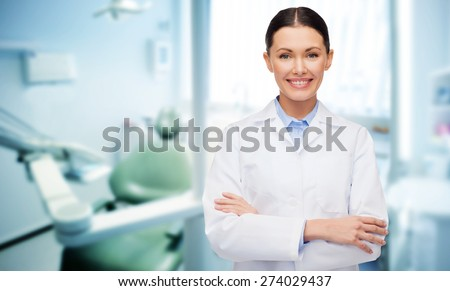 people, medicine, stomatology and healthcare concept - happy young female dentist with tools over medical office background - stock photo