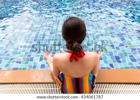 people meditation yoga  relax and wellness concept with swimming pool - stock photo