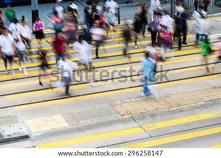 People movement on crossing street - stock photo
