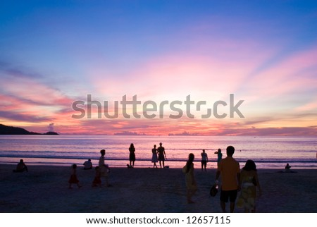 people on sunset beach, Patong beach, Phuket, Thailand - stock photo