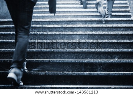 People on the staircase in rain - blurred motion - stock photo