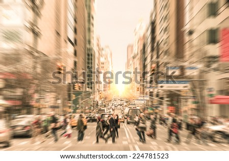 People on the street on Madison Avenue in Manhattan downtown before sunset in New York city - Commuters walking on zebra crossing during rush hour in american business district - stock photo