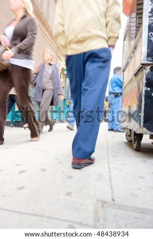 People on the streets of New York - lens and motion blurred - stock photo