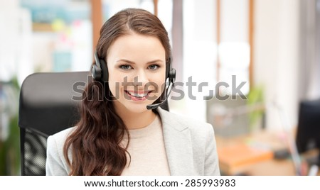 people, online service, communication and technology concept - smiling female helpline operator with headset over office background - stock photo