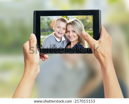 people photographed on a smartphone family - stock photo