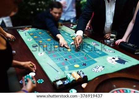 People playing poker in the casino, roulette, gambling - stock photo