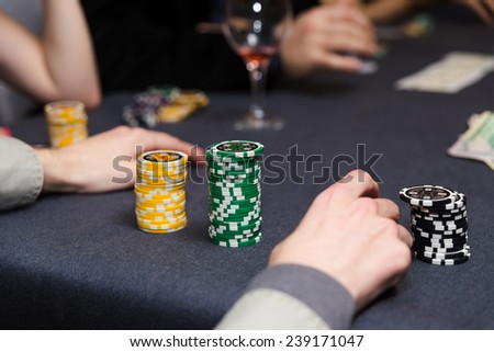 People playing poker. Players hands on table. - stock photo