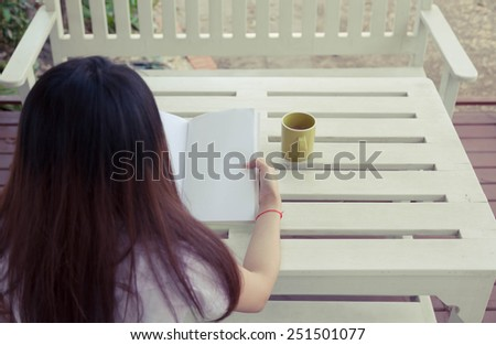 People reading books on the table - stock photo