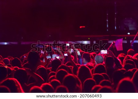 people recording a concert with mobile phones - stock photo
