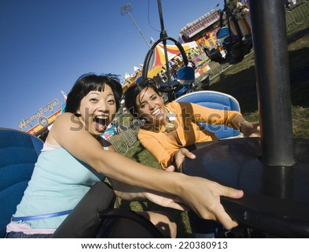 People riding a roller coaster - stock photo