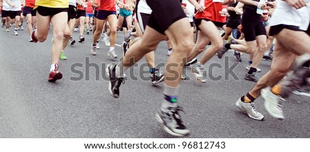 People running marathon on city street, sport and fitness on the urban road. Runners on the race, only legs and shoes - stock photo