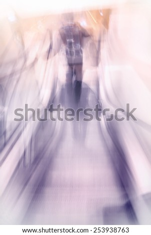 People rush and escalator stairway motion blurred. Vintage effect style image - stock photo