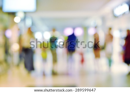 People rushing in the lobby. Blurred background of shopping center - stock photo