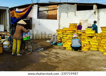 People's Daily life, fishing village with a lot of fishes in fishing basket at traditional fish market on the Long Hai beach. This market only happens in early morning. - stock photo