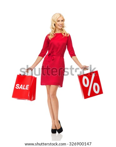 people, sale, discount and holidays concept - smiling woman in red dress with shopping bags - stock photo