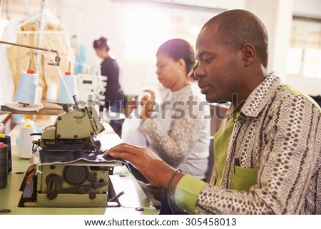 People sewing at a community project workshop, South Africa - stock photo