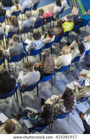 People Sitting in Lines on the Meeting or Conference. Vertical Image - stock photo