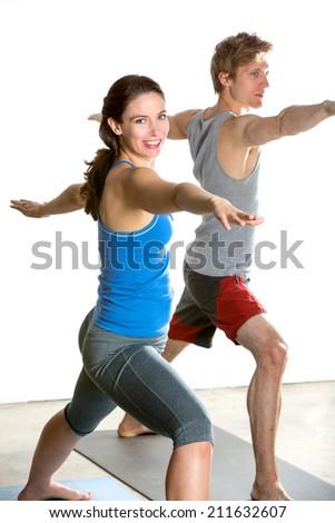 People sitting in yoga pose in fitness studio - stock photo