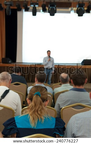 people sitting rear at the business conference and speaker - stock photo