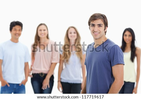 People smiling with one in foreground against white background - stock photo