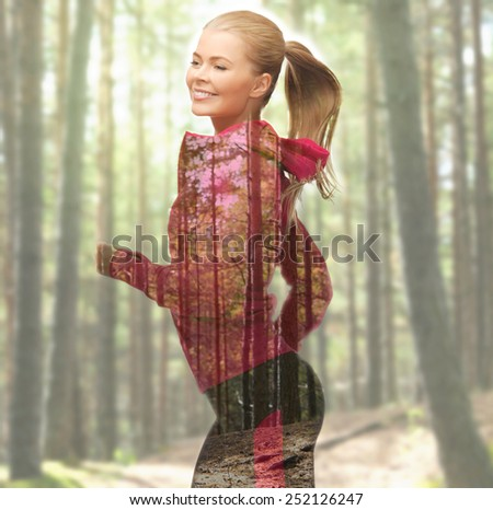 people, sport, fitness, slimming and double exposure concept - happy woman running or jogging over woods background - stock photo