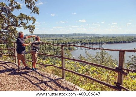 People standing at a scenic overlook on the Mississippi River  - stock photo