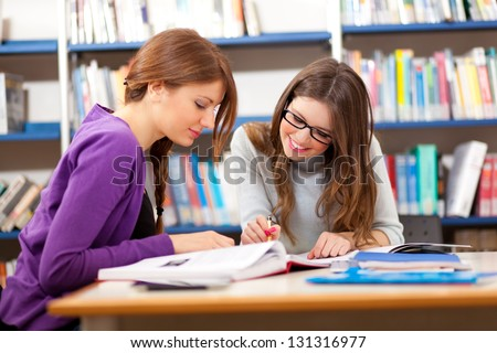 People studying together in a library - stock photo