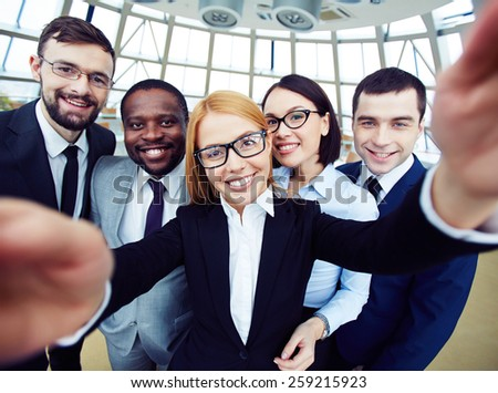 People taking selfie at business meeting - stock photo