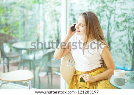 People talking by mobile phone - stock photo