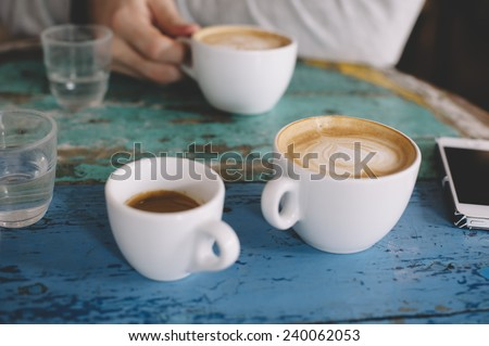People talking in the cafe while having some fresh coffee - stock photo