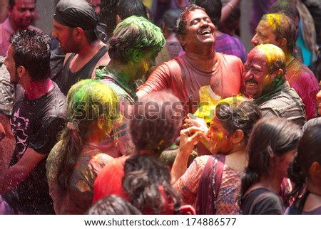 People throw colors to each other during the Holi celebration on March 27, 2013, Mumbai, Maharashtra, India. Holi is the most celebrated religious color festival in India. - stock photo