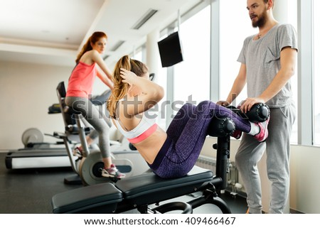 People training abs in gym and working on losing weight - stock photo