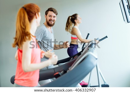People training in gym on various machines as part of cardio workout - stock photo