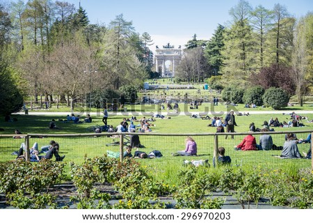 People visiting the Parco Sempione large central park, Mialn Italy 20.04.2015 - stock photo