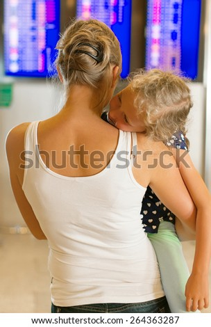 People waiting for flight. Tired child. - stock photo