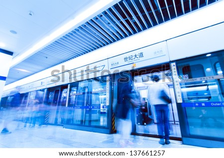 People waiting to catch a train in shanghai china. - stock photo