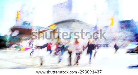 People waking through intersection in the city.  Motion and blur are evident.  Its a cheery scene that also communicates mystery. - stock photo